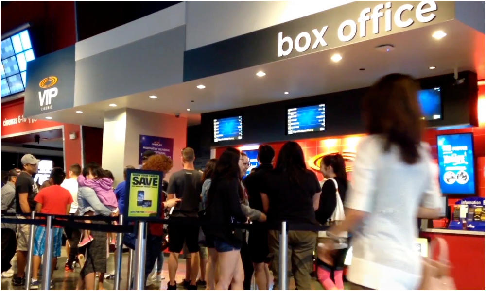 Standing In Queues For Long Hours To Buy Movie Tickets